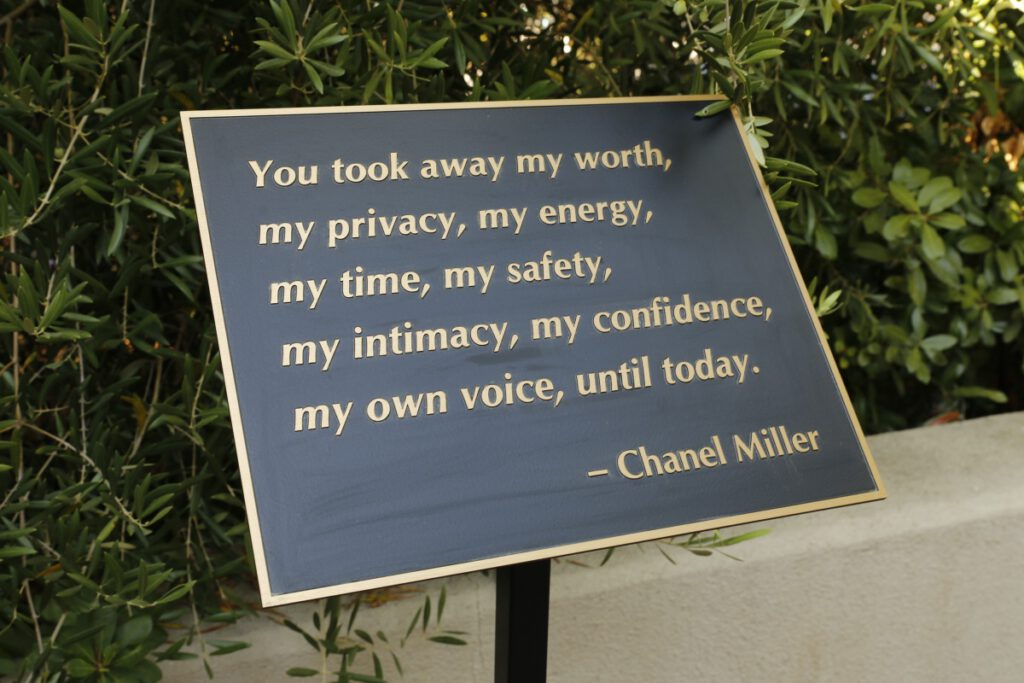 """A plaque quoting Chanel Miller saying, """"You took away my worth, my privacy, my energy, my time, my safety, my intimacy, my confidence, my own voice, until today."""""""